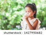 cute asian child girl is... | Shutterstock . vector #1427950682