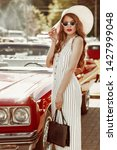street fashion portrait of...   Shutterstock . vector #1427999048