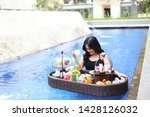 woman drinking coffee table... | Shutterstock . vector #1428126032
