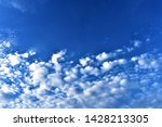 fluffy clouds in blue sky as... | Shutterstock . vector #1428213305