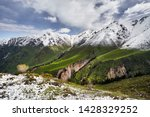Mountain Peak With Snow And...