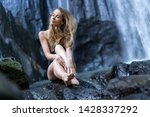 beautiful girl sitting on the... | Shutterstock . vector #1428337292