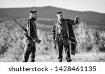 Small photo of Gamekeeper rifles nature environment. Gamekeepers walk mountains background. Gamekeepers sunny fall day. Gamekeeper occupation concept. Hunting with partner provide greater safety fun and rewarding.