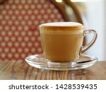 Stock photo cappuccino with full fine bubble cream little cacao powder served in clear glass coffee cup small 1428539435