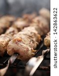 fresh meat on a steel skewer in ... | Shutterstock . vector #142863622