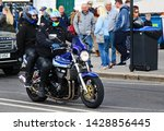Small photo of Hastings,East Sussex/UK 05/06/19 Bike 1066 the annual May Day bike run to Hastings. A blue Suzuki bike with pillion passenger arrives on the seafront.