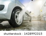 man cleaning vehicle with high... | Shutterstock . vector #1428992315