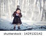 little cute boy is eating a... | Shutterstock . vector #1429132142