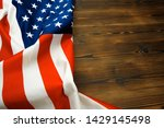 american flag on a old wooden... | Shutterstock . vector #1429145498