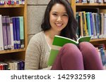 student sitting in a library on ... | Shutterstock . vector #142932598