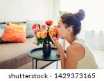 Woman Smelling Fresh Roses In...