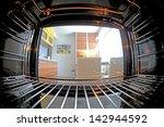 inside oven with fisheye lens | Shutterstock . vector #142944592