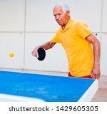 Mature Man In Yellow Tshirt...