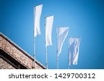 three blank white flags on...   Shutterstock . vector #1429700312