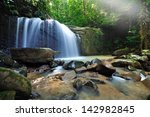 Waterfall In The Jungle With...