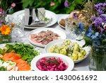 Stock photo scandinavian midsummer feast with potato salad herring salmon and beetroot 1430061692