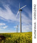 windmills and yellow flowers | Shutterstock . vector #143012542