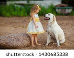 little girl with a labrador dog ... | Shutterstock . vector #1430685338