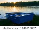 fishing boat in a calm lake... | Shutterstock . vector #1430698802