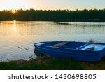fishing boat in a calm lake... | Shutterstock . vector #1430698805