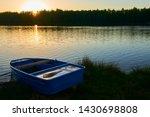 fishing boat in a calm lake... | Shutterstock . vector #1430698808