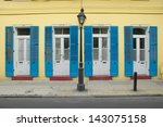 Blue shutter and lamppost in French Quarter near Bourbon Street in New Orleans, Louisiana