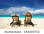 couple on a tropical beach at... | Shutterstock . vector #143103712