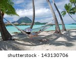 young lady on the hammock at...   Shutterstock . vector #143130706