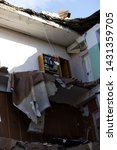 Small photo of destruction by an explosion in a high-rise building. concept of natural disasters, anti-terrorism and the explosion of domestic gas. inaccessible bookcase