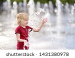 little boy plays in the square... | Shutterstock . vector #1431380978