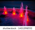 Fountain Water Jumping With Red ...