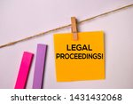 Small photo of Legal Proceedings! on sticky notes isolated on white background.
