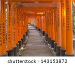 Pathway Under Tunnel Of Torii...