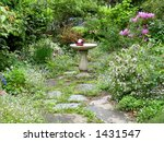 Gazing Ball in English Country Garden - stock photo