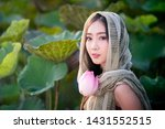 Woman Holding Lotus With...