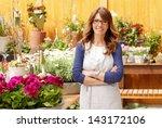 smiling mature woman florist... | Shutterstock . vector #143172106
