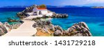 Small photo of Authentic traditional Greek islands- unspoiled Chios, little church in the sea over the rocks Agios Isidoros