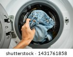 Putting Jeans Into The Washing...