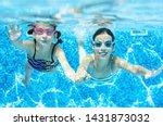 Children Swim Underwater In...