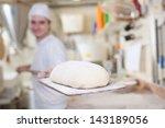 Baker Preparing A Handmade Loa...