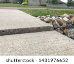 Small photo of Frost heave crack in residential concrete sidewalk