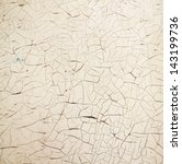 small cracks on the old beige wall - stock photo