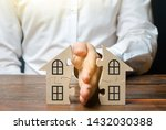 Small photo of A lawyer shares a house or property between owners. Divorce concept. The division process of real estate and property between former spouses, relatives. Execution of the posthumous will.