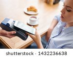 paying with smartphone in...   Shutterstock . vector #1432236638