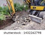 Small Excavator Is Excavating...