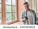 handsome man is standing near... | Shutterstock . vector #1432394828