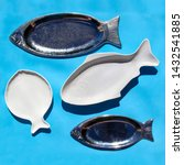 Empty fish shaped silver and...