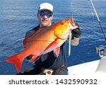 Deep Sea Fishing  Man Holding A ...