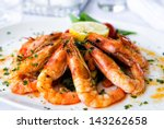 Fried Shrimps On A Plate With...