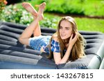 Happy Young Woman Lying On The...